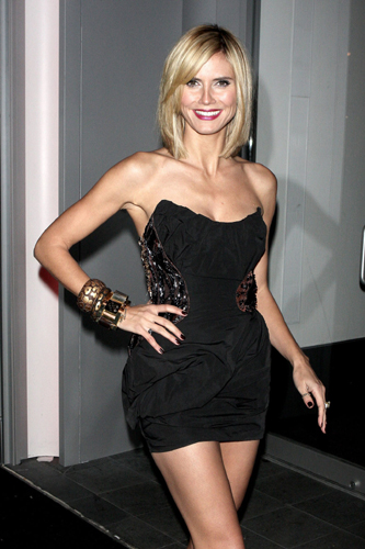 Heidi Klum cut her hair into a longer version bob. not as short as Katie