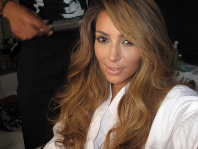 trend with some blonde hair extensions underneath her light brown hair: